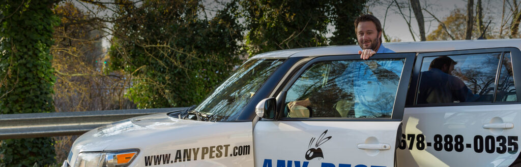Pest Control Professional Male in Truck   Any Pest Inc.
