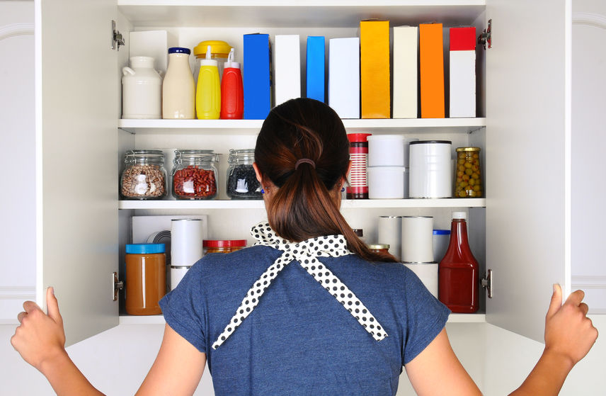 Women Looking In Crowded Pantry | Any Pest